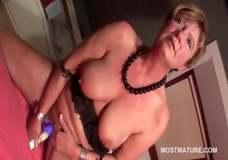 Excited mature blonde self fucks with vibrator