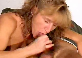 older gives a blowjob with spunk flow in throat